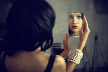 woman-looking-herself-in-mirror